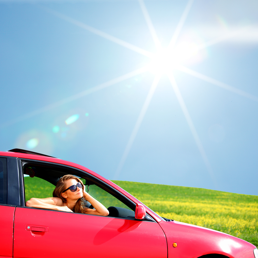 lady sitting in car in bright sunshine
